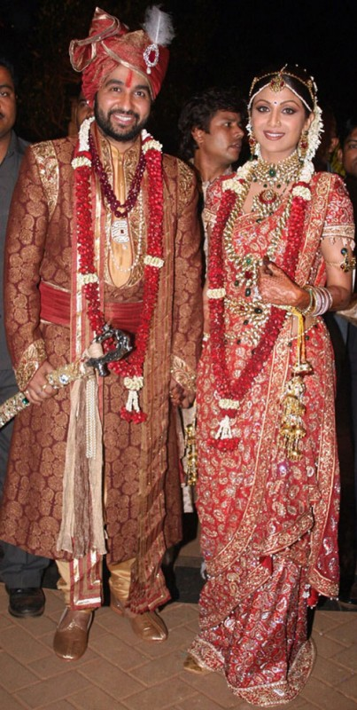 Shilpa shetty the bride and hubby in red color dress combination