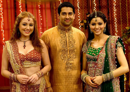 Aftab shivdasani in golden sherwani with pretty ladies in red and green bridal lehenga