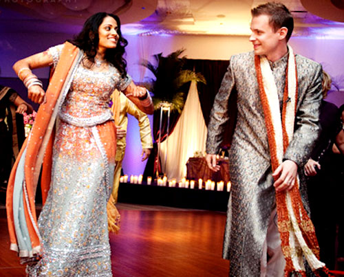 silver and orange lehenga and sherwani