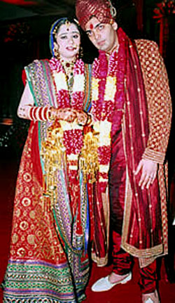 red lehenga and red sherwani