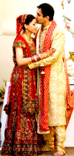 red and golden lehenga and sherwani