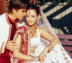 red and white lehenga and sherwani