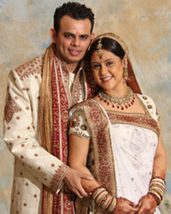 Red and white bridal saree and sherwani