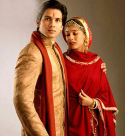 golden sherwani and red lehenga