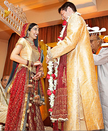 red bridal lehenga  and golden groom sherwani