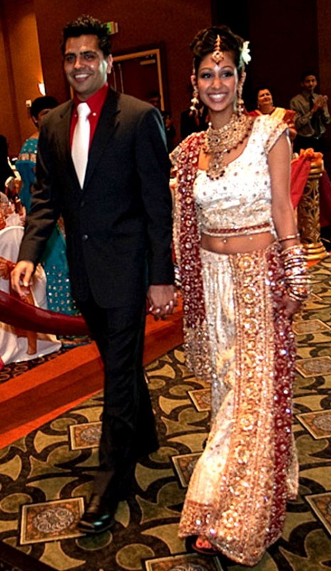 black suit and red and white bridal lehenga