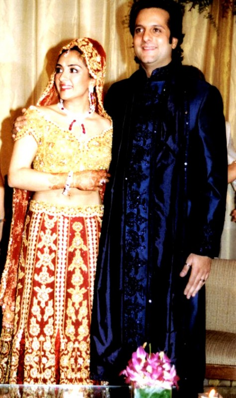 Fardeen khan in navy blue sherwani and bride in red lehenga and golden blouse