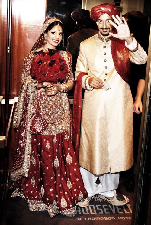 heavy red lehenga and light golden sherwani with white pyajama