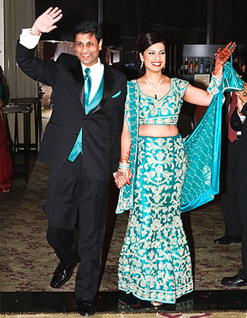 blue bridal lehenga with black suit and blue tie