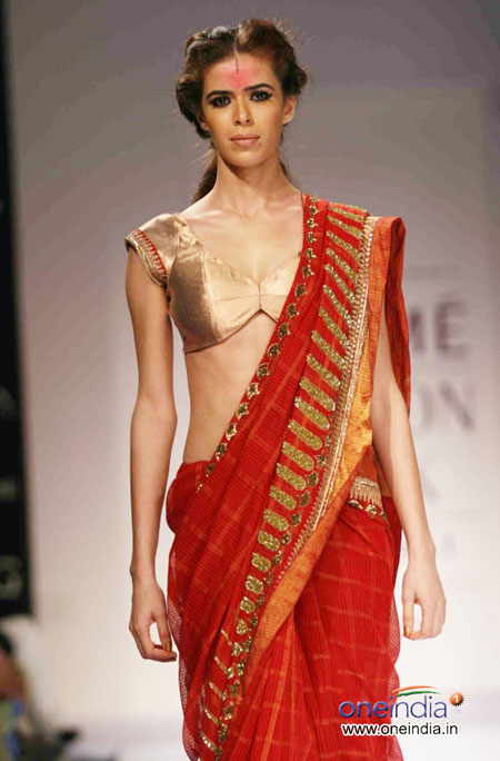 Red saree with golden blouse