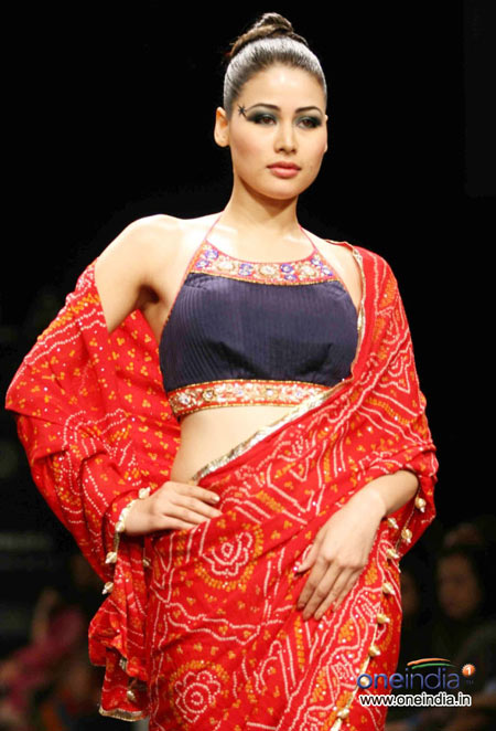 Red print saree with navy blue contrast blouse