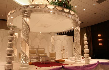 Stage decoration in white color with beautifully carved pillars