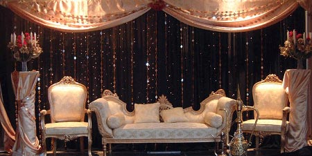 Shimmering black and cream colored stage decoration
