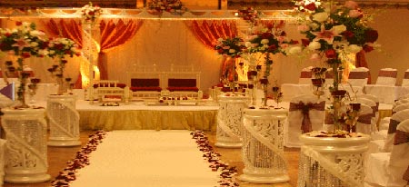 Red and cream colored stage decoration
