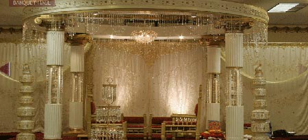 Shiny cream colored stage decoration with a touch of red