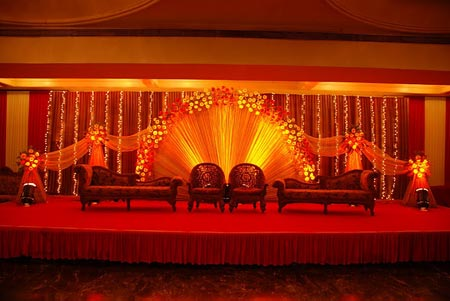 Magnificently decorated stage with red and yellow colors