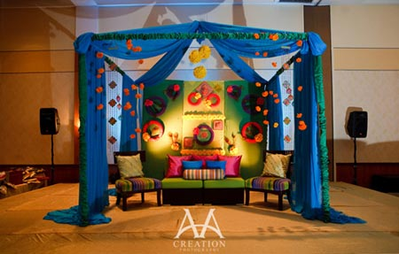 Stage decorated with blue and lot of additional colors