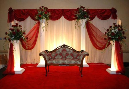 Red and white stage decoration with red chair