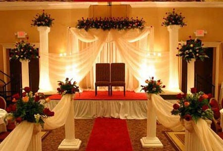 Lovely stage decorated with white drapes