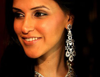 Neha Dhupia wearing a fine designed dangle earring
