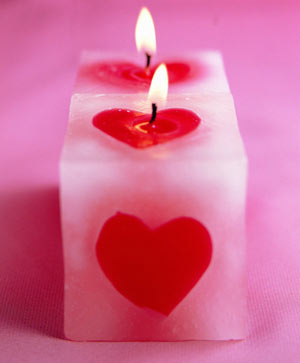 Red and pink candle with engraved heart