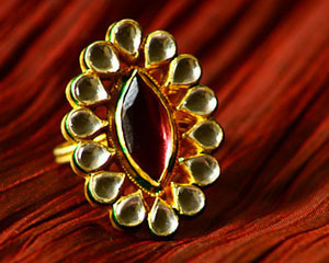 Finger ring with large tilak shaped red stone in center