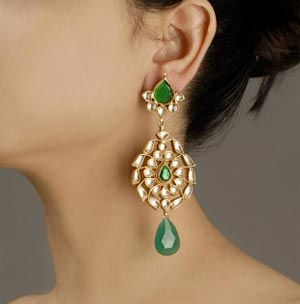 Earring with green tourmalines and green onyx drop surrounded with kundan.