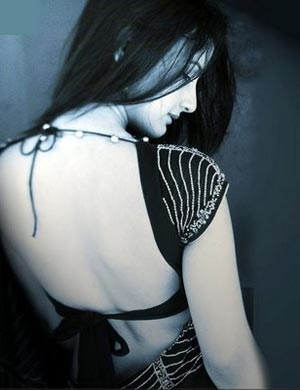 Gayathri Chowdary wearing a backless blouse with only 2 top and bottom strings