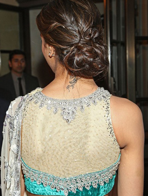 Deepika Padukone wearing a beautiful embroidered net blouse back