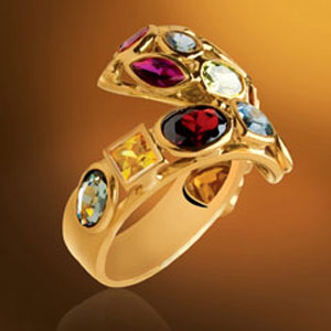 Golden ring with multi color stones stidded