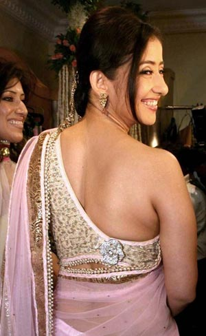 Manisha Koirala wearing a stylish one shouldered blouse back