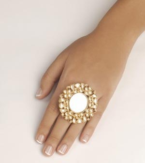 Fashionable ring with central mirror insert surrounded with flowing mughal floral motifs in kundan
