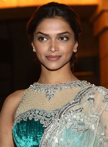 Deepika Padukone wearing a green blouse with net neck line