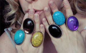 Mutliple big statement rings in bright colors
