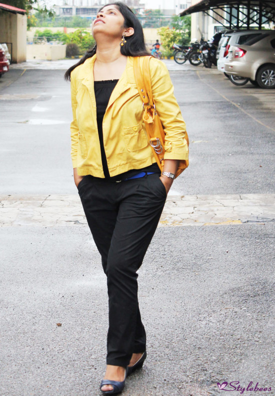 black pants with mustard jacket 1