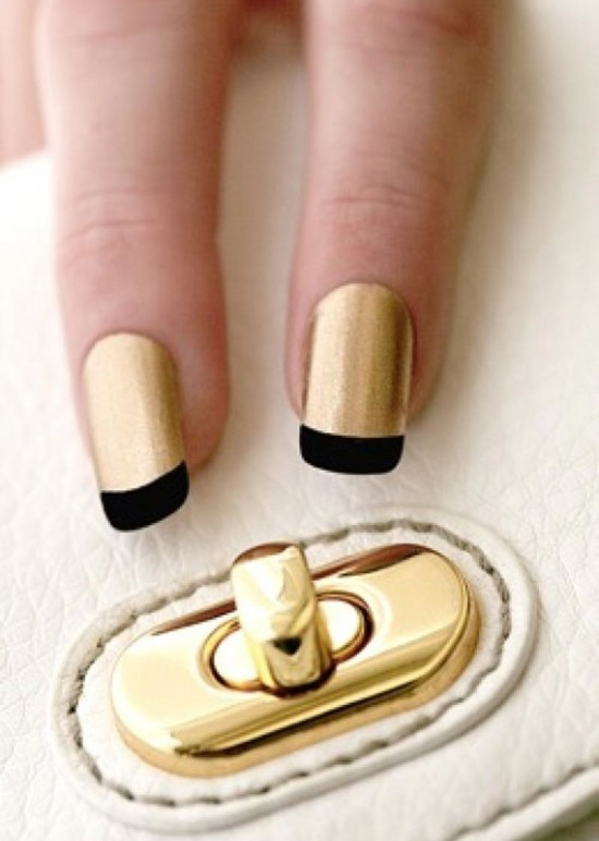 golden nails with black french tips