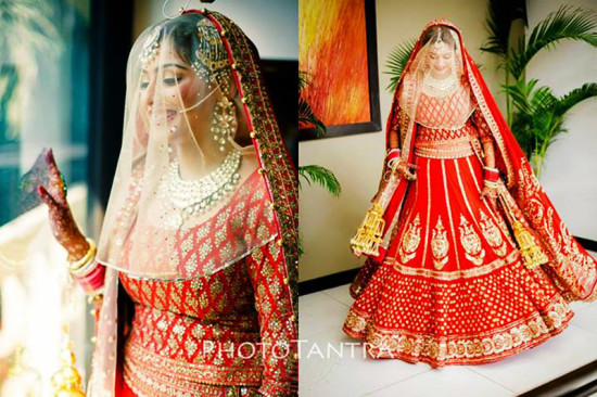 red lehenga choli with a viel